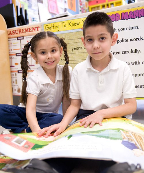 two children explore a giant book in an early childhood literacy program | Reading in Motion