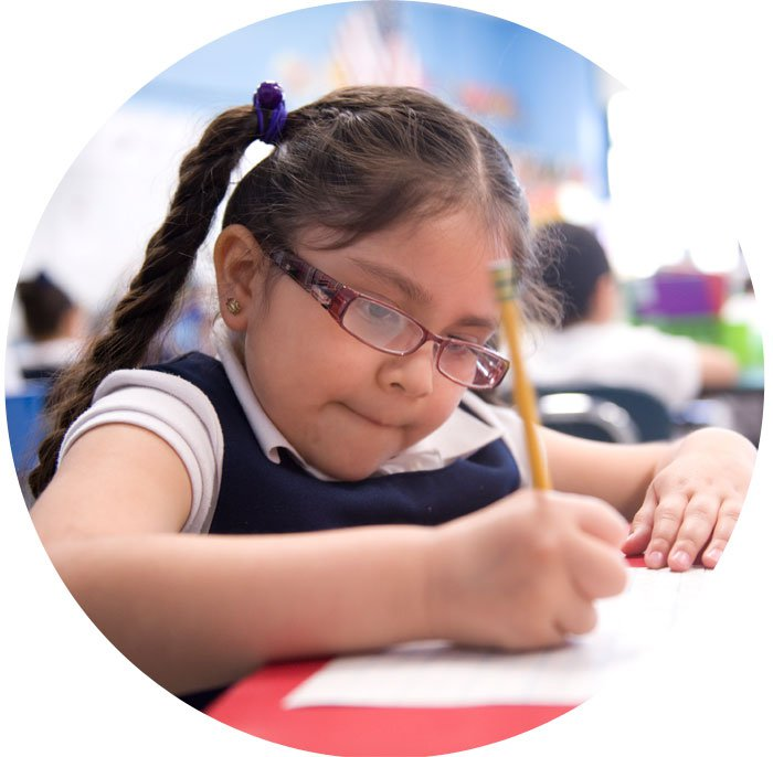a student in a first grade reading program practices writing | Reading in Motion